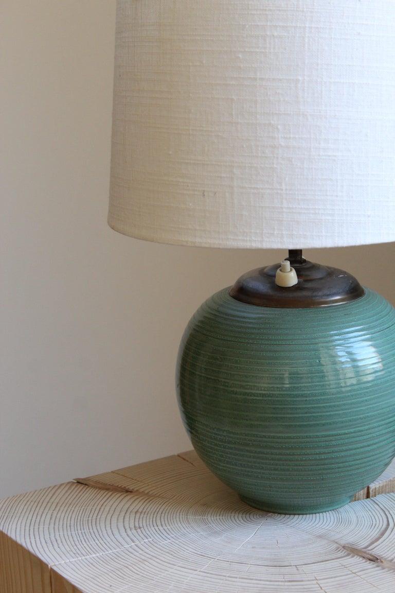 Scandinavian Modern Ekeby, Rare Table Lamp, Green-Glazed Stoneware, Brass, Linen, Sweden, 1930s For Sale