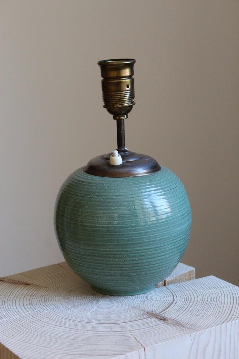 Swedish Ekeby, Rare Table Lamp, Green-Glazed Stoneware, Brass, Linen, Sweden, 1930s For Sale