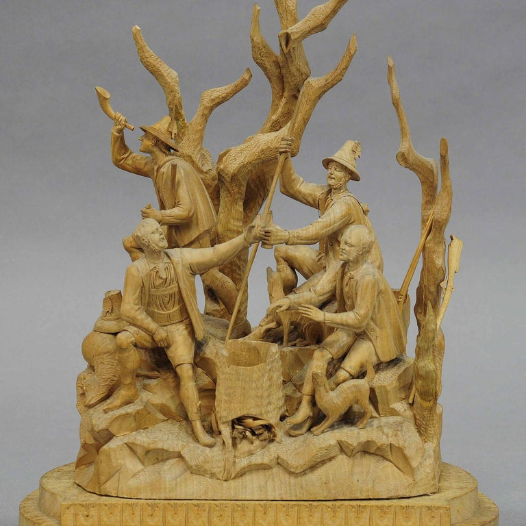 An antique elaborate carved tyrolian poacher group celebrating their hunt in the forest. most probably brienz, second half of the 19th century  Measures: Width 9.84