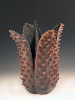 """""""Bristled Beauty"""", a fantastic flower with, black interior with iron red petals"""
