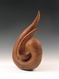 """Coexistence"", curved clay forms press against each other in a rhythmic cluster"