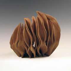 """Fragment 3"", layered ceramic shell, swirls in rich browns"