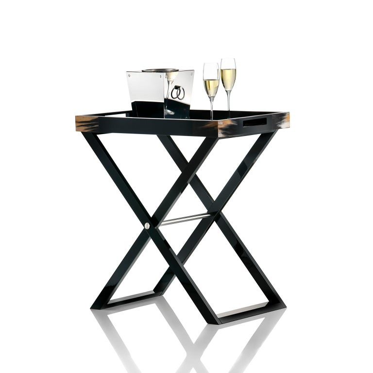 Beautiful texture and elegant appeal make our Elba butlers serving table a stunning addition to a contemporary interior. Unique accents in Corno Italiano bring a truly individual touch to the structure crafted of polished black lacquered wood, with