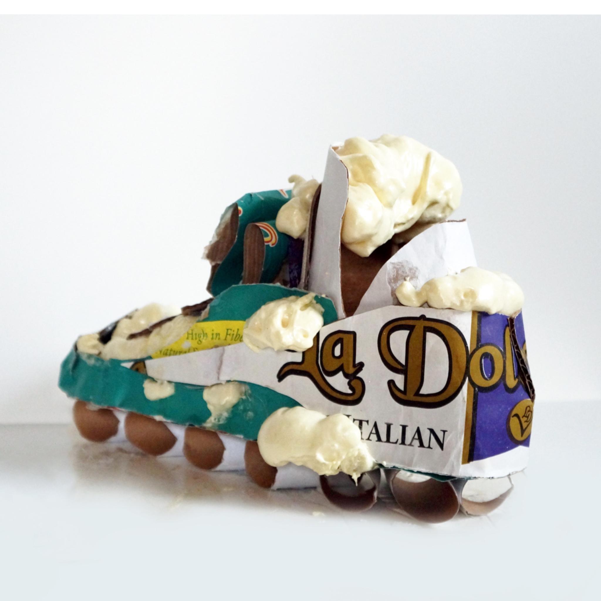 La Vita - sneaker sculpture with found paper and foam spray, textural shoe