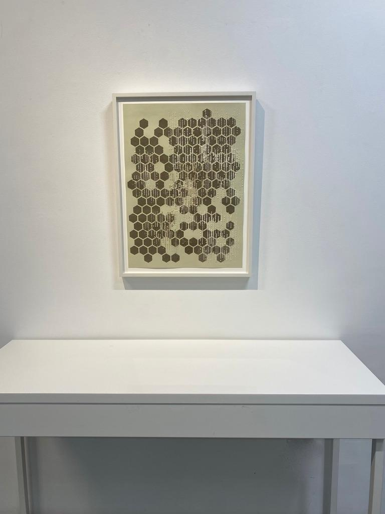 Carefully applied non-traditional materials add texture and interest to this vertical, abstract work on paper by Eleanor White. Brown wood ash and chicken eggshell are layered with a polymer medium and carefully applied on paper painted in an