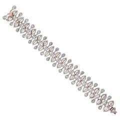 Elegant 18 Karat White and Pink Gold, and Diamond Bracelet