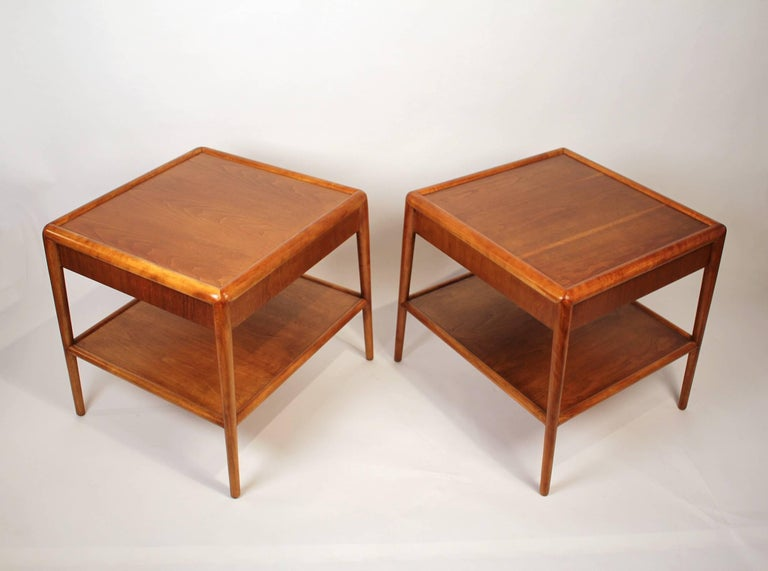 Elegantly designed pair of Gibbings night stands or end tables for Widdicomb from the 1950s. The mahogany has been professionally refinished and is in very good condition. Signed with fabric labels.