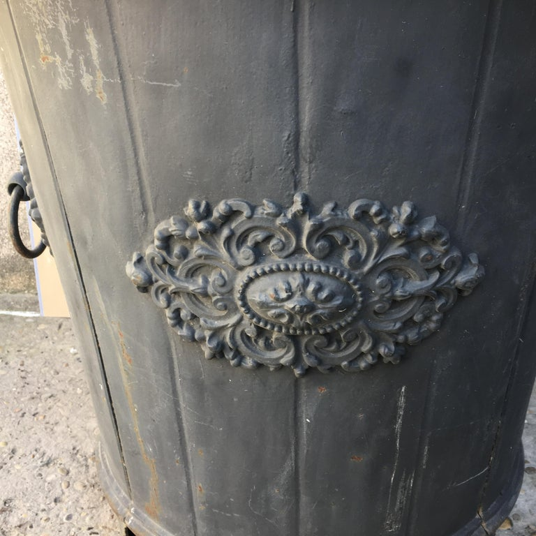 An elegant French cast iron garden planter or urn with a stunning blue green patina. Beautiful slate blue color. Decorative designs on all 4 sides with two handles. Strong supporting feet below the base.  This beautiful planter originates from a