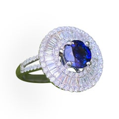 Elegant 4.04 Carat Sapphire and Diamond Ballerina Design White Gold Ring