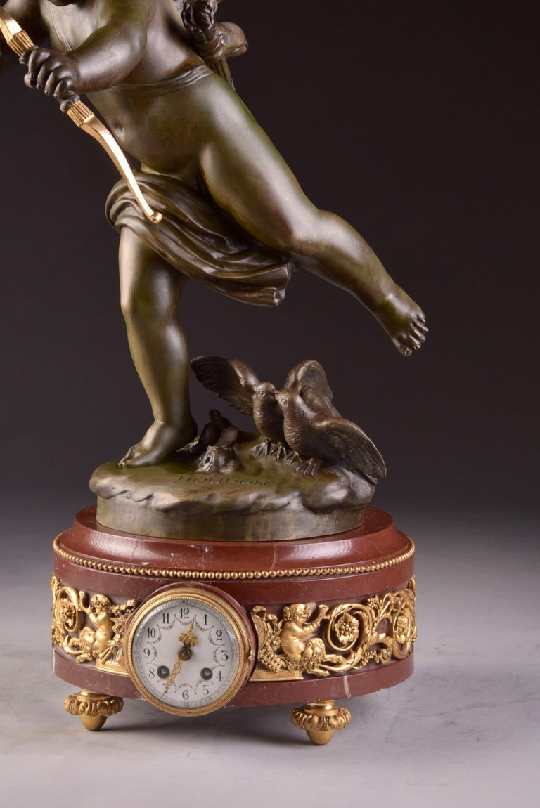 Gilt Elegant and Large Cupid 'Houdon' Pendulum, with Candle Sticks 'Clodion' For Sale