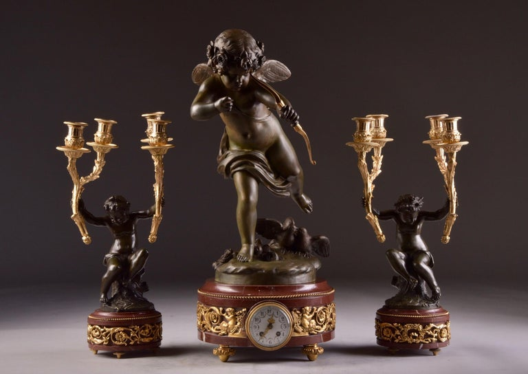 Elegant and Large Cupid 'Houdon' Pendulum, with Candle Sticks 'Clodion' In Good Condition For Sale In Ulestraten, Limburg