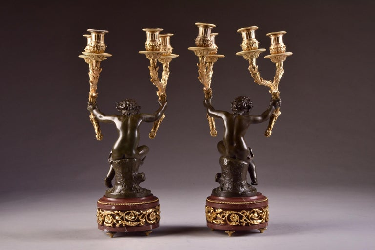 19th Century Elegant and Large Cupid 'Houdon' Pendulum, with Candle Sticks 'Clodion' For Sale