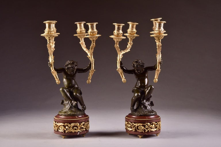 Marble Elegant and Large Cupid 'Houdon' Pendulum, with Candle Sticks 'Clodion' For Sale