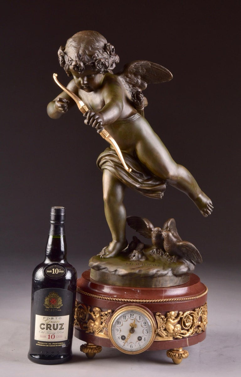 Beautiful large French cupid mantel clock (65 cm), with large cupid, work of Jean Antoine Houdon (French 1741-1828), patinated bronze, marble, second half of the 19th century.  Rare large cupid mantel clock on marble base. Bronze cupid is signed