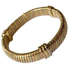 Elegant and Timeless Cartier Tubogas 18 Karat Tricolor Gold Bracelet