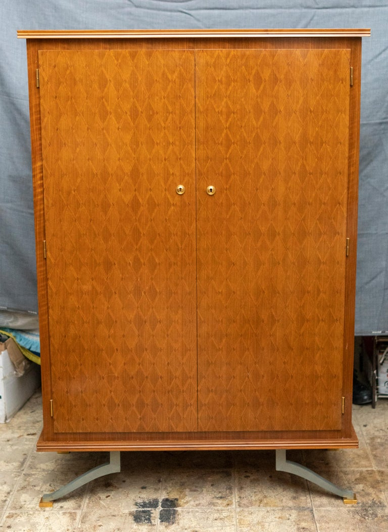 Elegant Art Deco period sycamore marquetry cabinet by Jules Leleu. Fitted with gilt bronze locks and resting on patinated steel and gilt bronze feet. The interior includes a bar with sycamore shelves, mirrored floor for bottles or glass