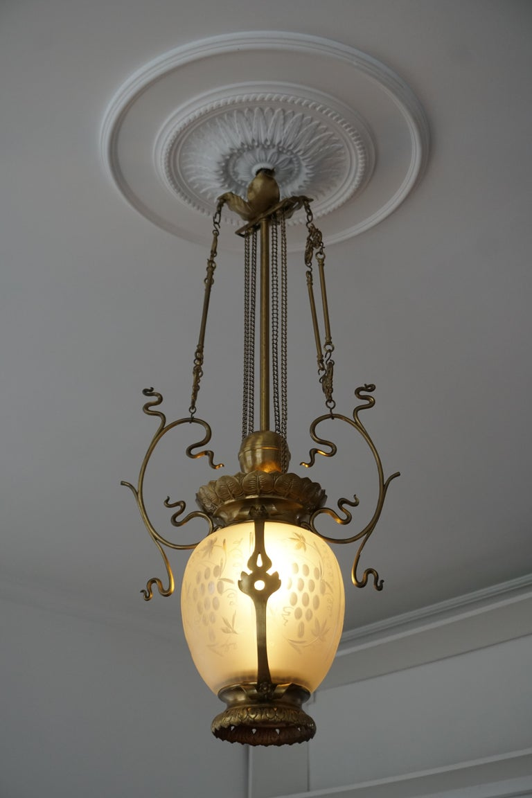 20th Century Elegant Art Nouveau Pendant Light in Brass and Glass For Sale