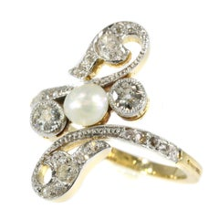 Elegant Belle Époque Diamond and Pearl Engagement Ring