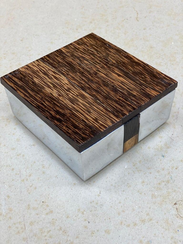 Elegant box in polished cast aluminum and palm wood, circa 1970.
