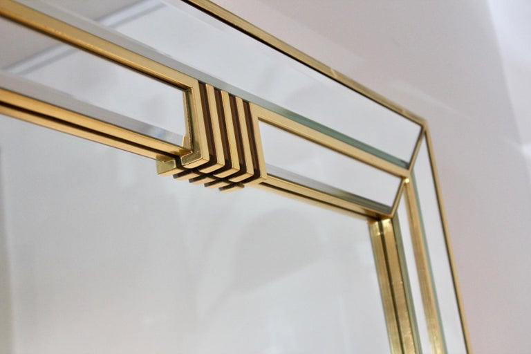 Beautiful large brass framed mirror with sophisticated Graphical design. Made in Belgium by Deknudt in the 1970s. The frame has some wear due to normal use and age. The mirror has a beautiful patina. Very elegant with beautiful and unique inset