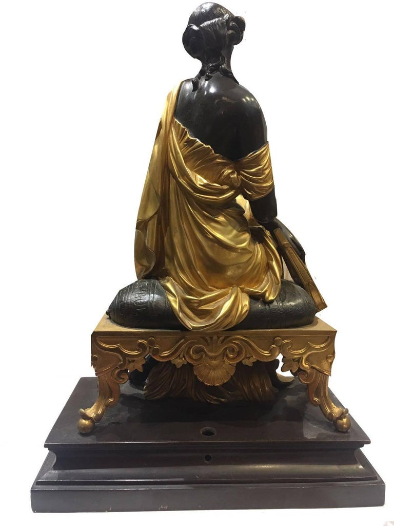Elegant bronze figurine, a female sitting down. Signed by François-Théodore Devaulx, French.