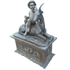 Elegant Bronze Statue of a Child and a Goat on a Column