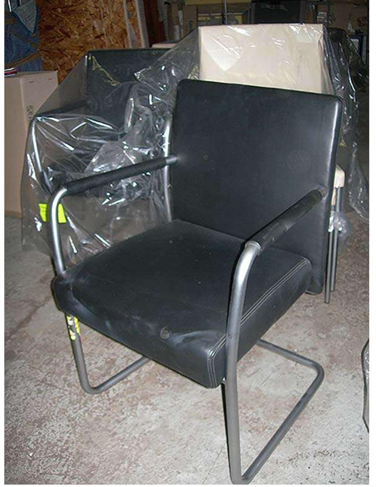 (2) Jason armchairs Cantilever matt chrome base Black leather / leather wrapped arms Model#1519V Measures: W 23.2