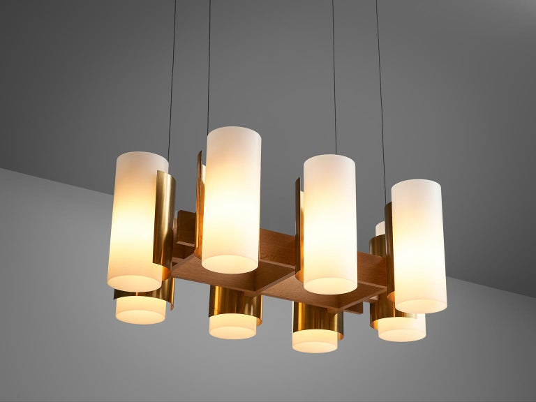 Sten Carlquist for Hans-Agne Jakobsson, chandelier in brass, oak and acrylic, Sweden, 1960s.   Large chandelier designed by Sten Carlquist in the 1950s. This chandelier was designed for the