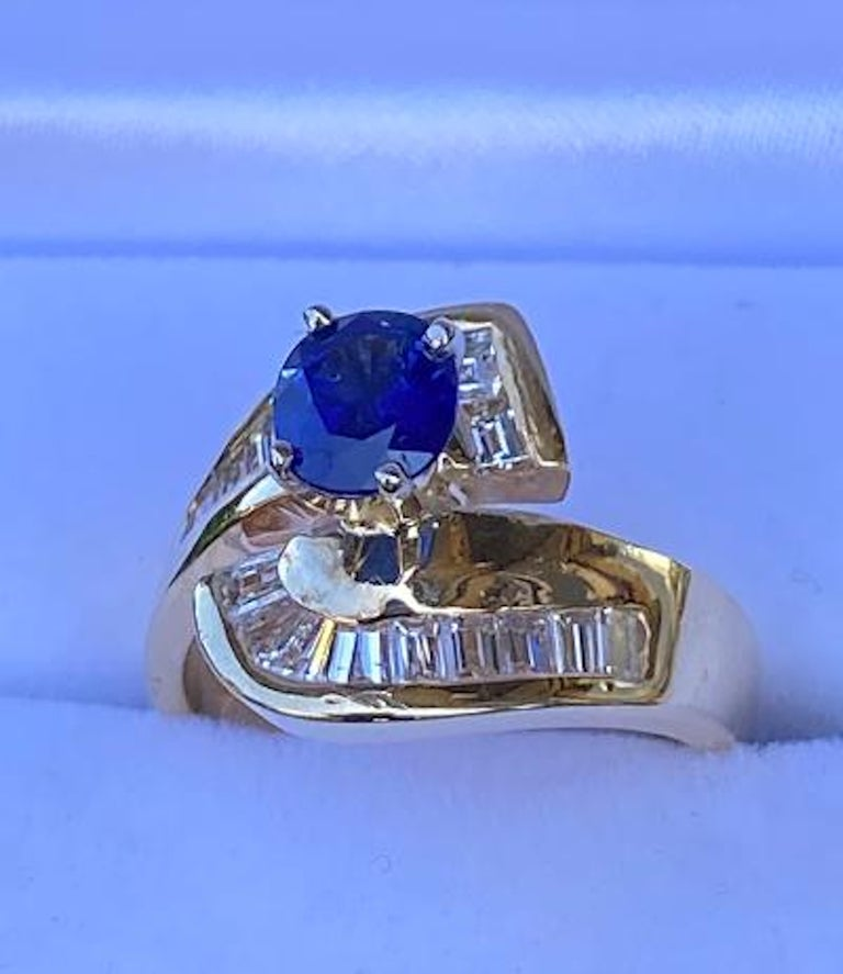 Oval Cut Elegant Cornflower Blue Sapphire and Diamond Bypass Design Yellow Gold Ring For Sale