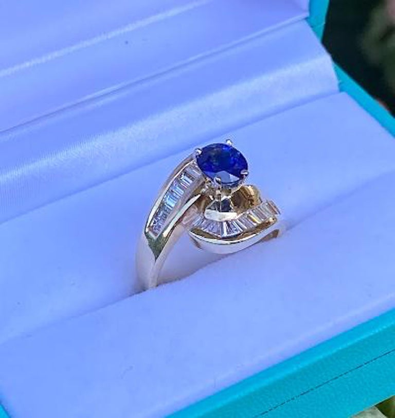 Women's Elegant Cornflower Blue Sapphire and Diamond Bypass Design Yellow Gold Ring For Sale