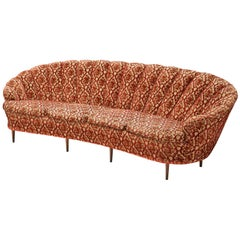 Elegant Curved Four-Seat Sofa in Floral Upholstery