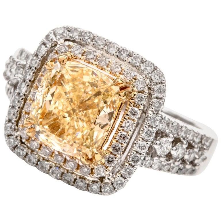 Elegant Cushion Yellow Diamond Double Halo 18 Karat Engagement Ring For Sale