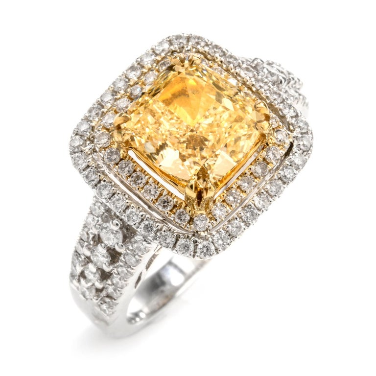 Elegant Cushion Yellow Diamond Double Halo 18 Karat Engagement Ring In Excellent Condition For Sale In Miami, FL