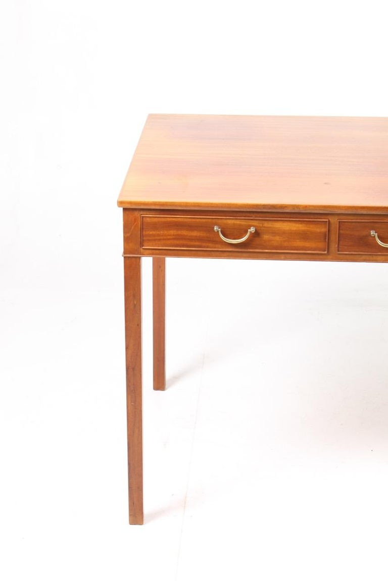 Elegant freestanding Danish design desk in mahogany with three drawers designed by Ole Wanscher for A.J. Iversen in the late 1950s. Made in Denmark, great original condition.