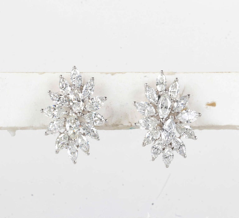 One of our favorite designs!  5.67 carats of G color VS clarity marquise cut diamonds set in 18k white gold.  For pierced ears