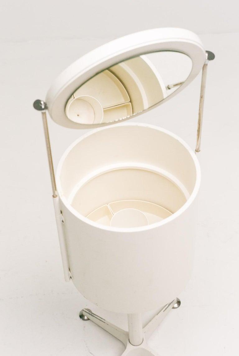 Delicate 1960s vanity with adjustable round mirror.