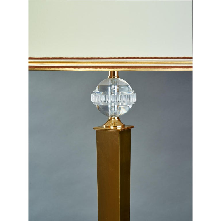 DOMINIQUE Andre Domin (1883-1962) & Marcel Genevriere (1885-1967). Exquisite neoclassical floor lamp, with sculptural oxidized bronze finish and polished brass mounts, with sharply tapered shaft and belted perspex globe ornament, France,