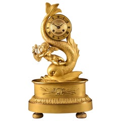 Elegant French Empire Mantel Clock with Putto and Dolphin, France, circa 1820