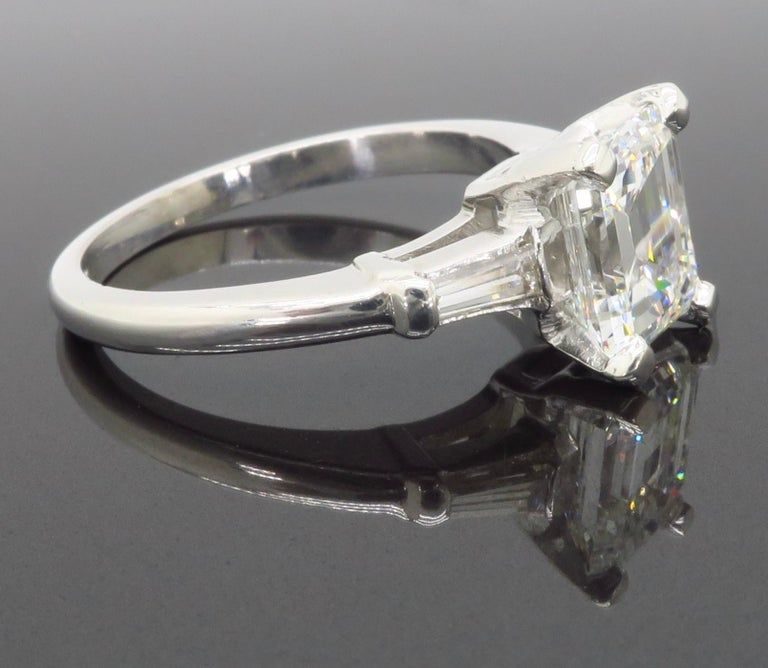 Elegant GIA Certified Emerald Cut Diamond Engagement Ring with Tapered Baguettes For Sale 11