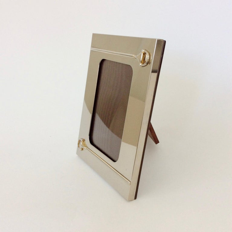 Gucci picture frame with stirrup motif, circa 1970, Italy.