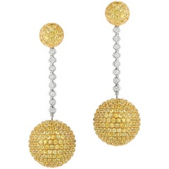 Elegant Hanging Earrings Set with Diamond and Yellow Sapphire