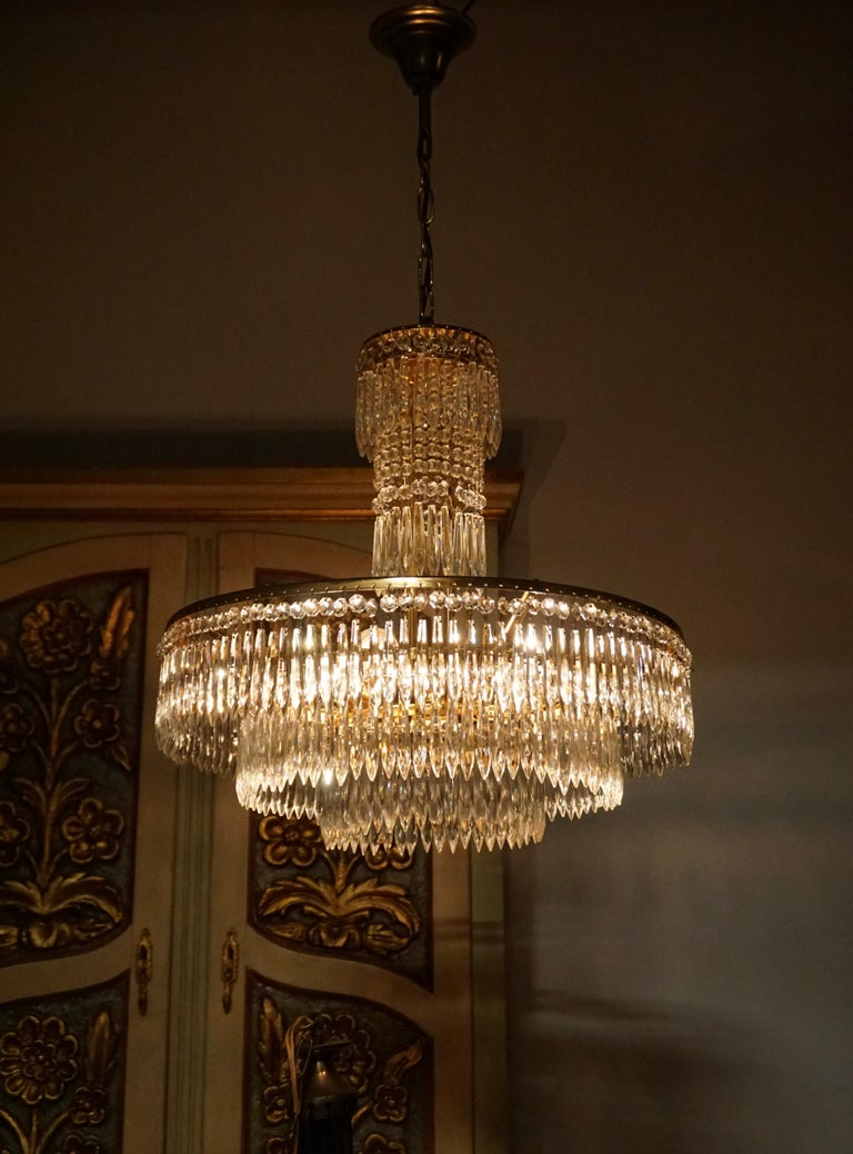 Belgian Elegant Hollywood Regency Crystal and Brass Chandelier For Sale