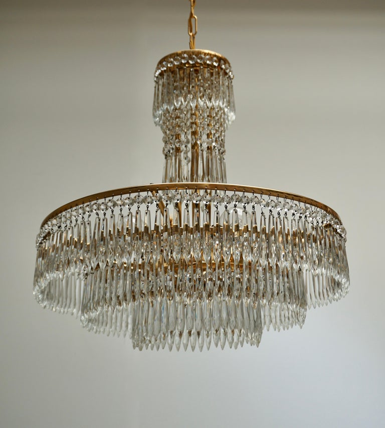 Elegant Hollywood Regency Crystal and Brass Chandelier For Sale 5