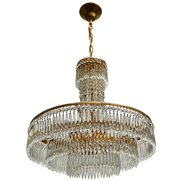 Elegant Hollywood Regency Crystal and Brass Chandelier For Sale