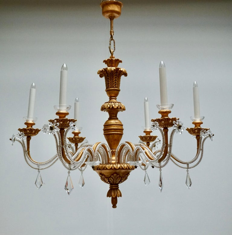 Elegant Italian Chandelier is Brass Wood and Glass In Good Condition For Sale In Antwerp, BE