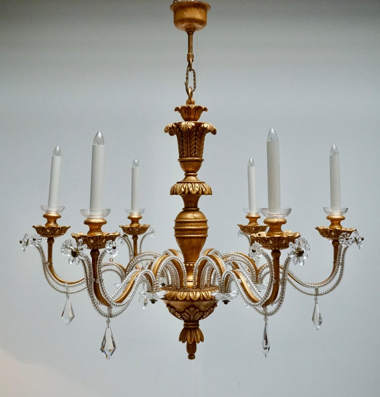 Elegant Italian Chandelier is Brass Wood and Glass For Sale 4