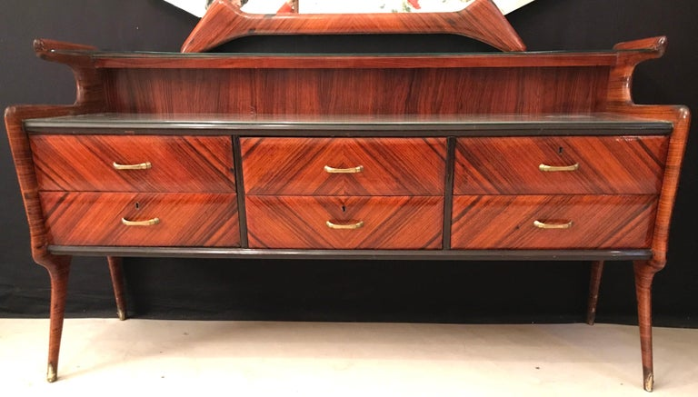 With six drawers. Gray painted glass top.