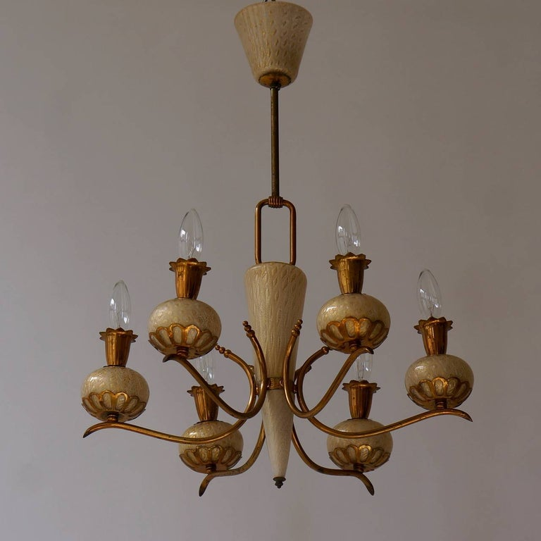 Elegant and charming exquisite hand blown Murano glass Barovier & Torso chandelier with gold inclusions. A six-light chandelier by Barovier & Toso.  Takes six small base bulbs (E-14) up to 60 watts per bulb.  Measures: Diameter 58 cm. Height 67