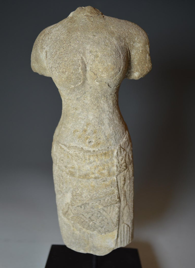A elegant Khmer female standing figure with rounded shoulders and breasts in Samapada position wearing pleated sarong This is a Angkor Period figure depicting the goddess Uma (Parvati), the consort of Shiva and Hindu goddess of fertility, in the