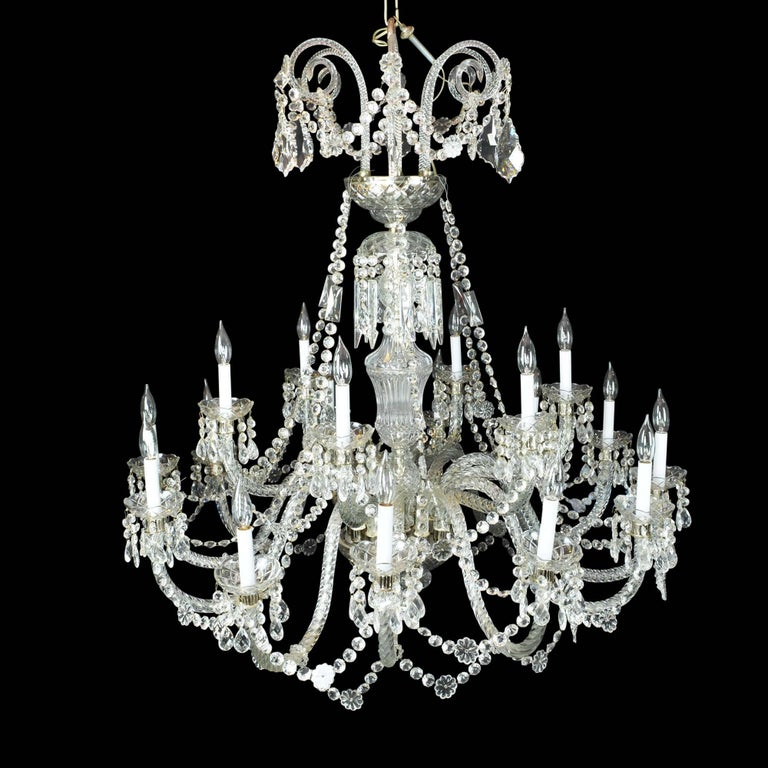 Stunning! There just aren't the words to describe how this light captures the room. This massive elegant two-tier crystal chandelier with eighteen chiselled crystal arms has plentiful draping in crystal beading accented by flowerets. It measures
